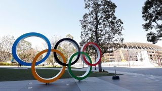 The Olympic rings appear next to Tokyo National Stadium