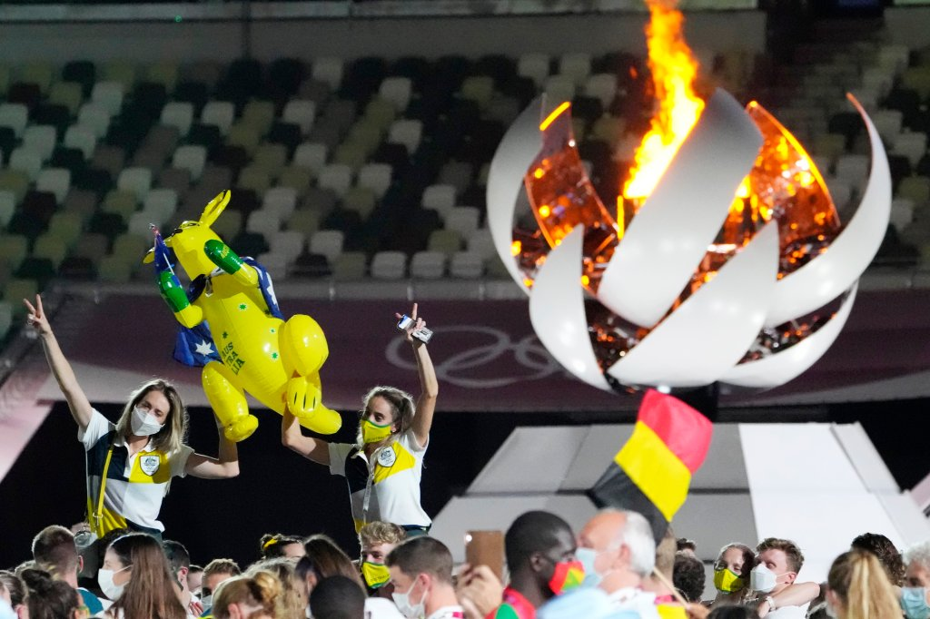 Australia's Sarah Carli, right, celebrates at the closing ceremony in the Olympic Stadium at the 2020 Summer Olympics, Sunday, Aug. 8, 2021, in Tokyo, Japan.