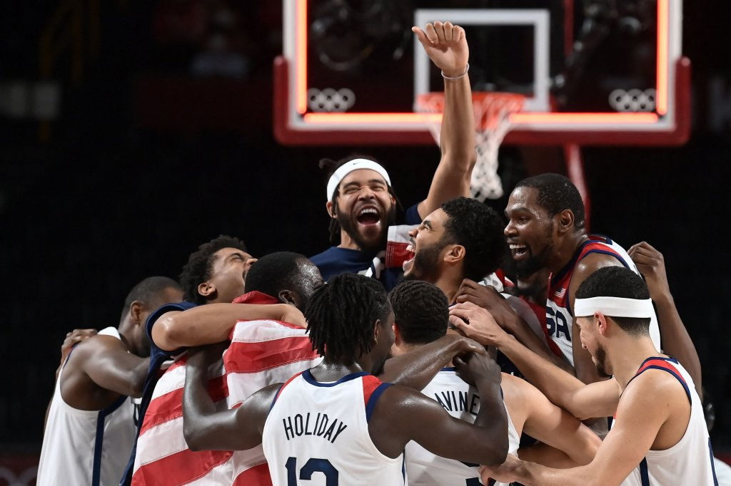 USA's players celebrate their victory at the end of the men's final basketball match between France and USA during the Tokyo 2020 Olympic Games at the Saitama Super Arena in Saitama, Japan on Aug. 7, 2021.