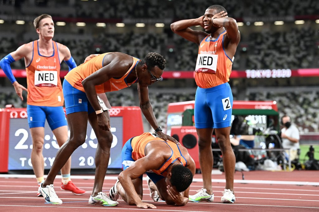 Netherlands' team react after taking second place in the men's 4x400m relay final during the Tokyo 2020 Olympic Games at the Olympic Stadium in Tokyo on Aug. 7, 2021.