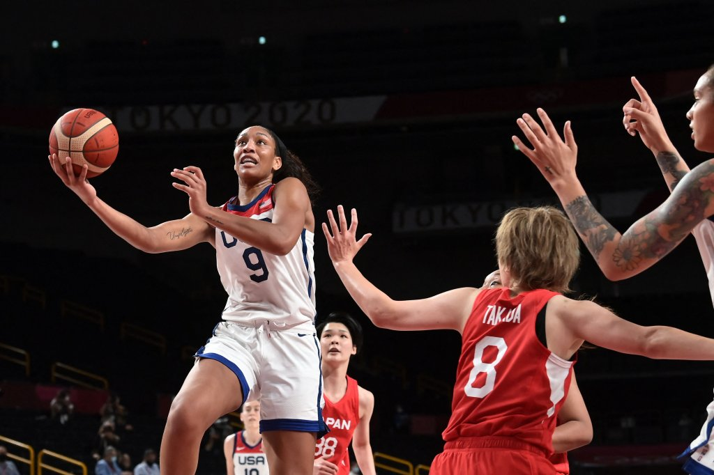 USA's A'ja Wilson (L) goes to the basket past Japan's Maki Takada (2R) in the women's final basketball match between USA and Japan during the Tokyo 2020 Olympic Games at the Saitama Super Arena in Saitama on Aug. 8, 2021.