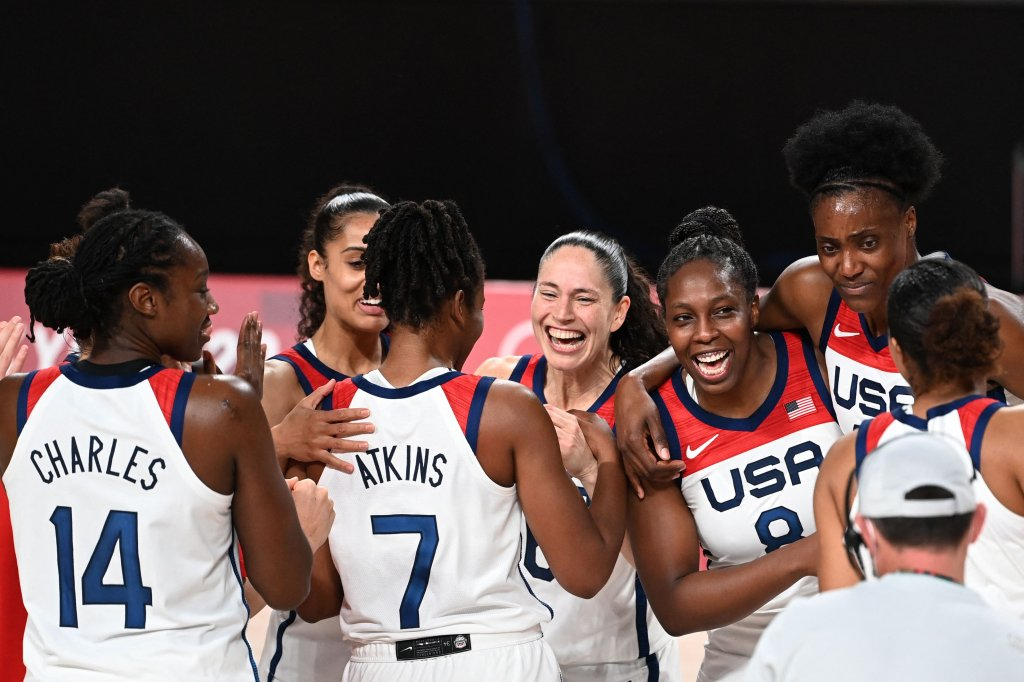 USA's players celebrate their victory at the end of the women's final basketball match between USA and Japan during the Tokyo 2020 Olympic Games at the Saitama Super Arena in Saitama on August 8, 2021.