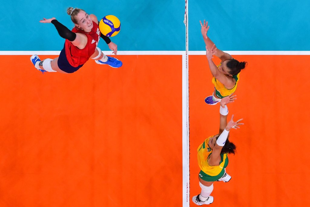 USA's Michelle Bartsch-Hackley (L) spikes the ball in the women's gold medal volleyball match between Brazil and USA during the Tokyo 2020 Olympic Games at Ariake Arena in Tokyo on Aug. 8, 2021.