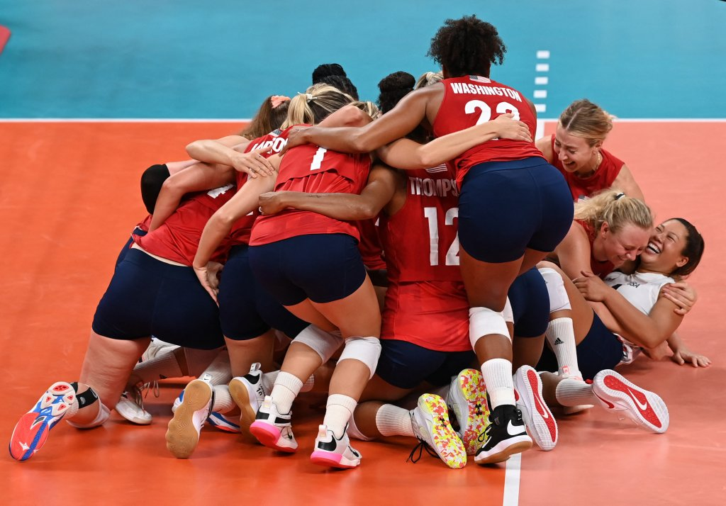 USA's players celebrate their victory in the women's gold medal volleyball match between Brazil and USA during the Tokyo 2020 Olympic Games at Ariake Arena in Tokyo, Japan on Aug. 8, 2021.