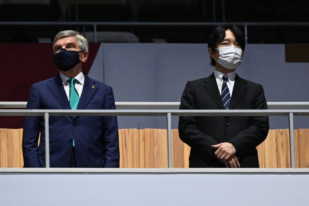 President of the International Olympic Committee (IOC) Thomas Bach, left, and Japan's Emperor Naruhito attend the closing ceremony of the Tokyo 2020 Olympic Games, at the Olympic Stadium, in Tokyo, on Aug. 8, 2021.