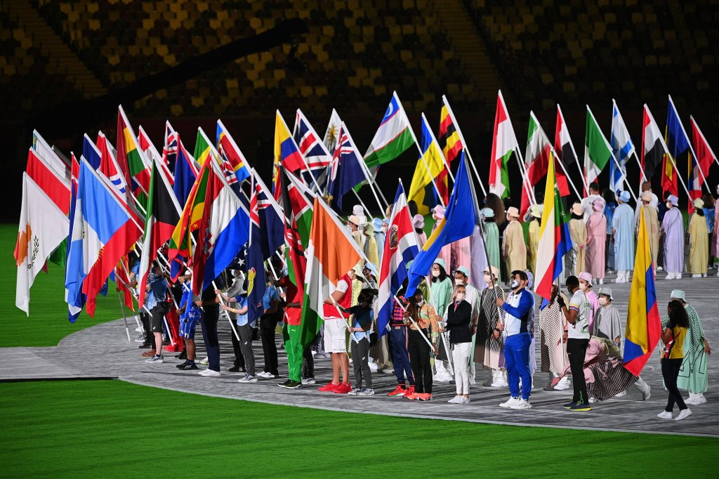Athletes carry their nations' flags to the field of play during the closing ceremony of the Tokyo 2020 Olympic Games, on Aug. 8, 2021 at the Olympic Stadium in Tokyo.