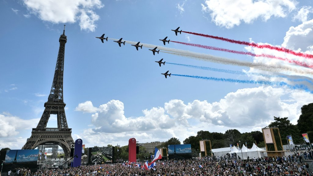 French aerial patrol fly over the fan village of The Trocadero set in front of The Eiffel Tower, in Paris on Aug. 8, 2021 upon the transmission of the closing ceremony of the Tokyo 2020 Olympic Games.