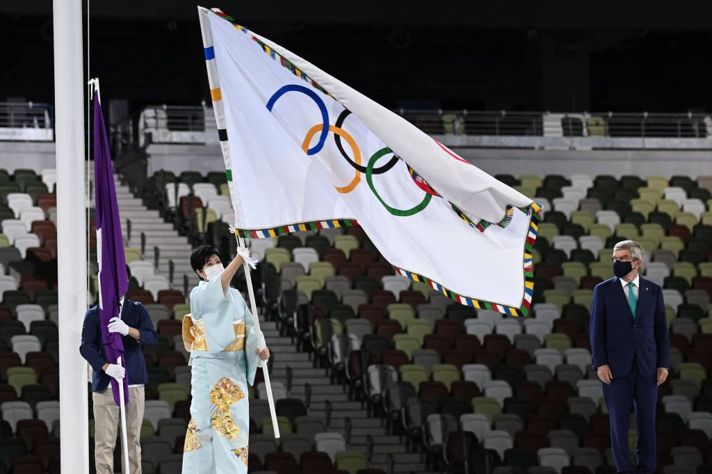 Tokyo's governor Yuriko Koike waves the Olympic flag during the closing ceremony of the Tokyo 2020 Olympic Games, at the Olympic Stadium, in Tokyo, on Aug. 8, 2021.