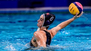 Margaret Steffens winds up to throw the water polo ball.
