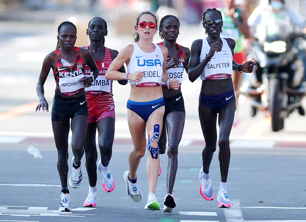 Peres Jepchirchir of Team Kenya, Eunice Chebichii Chumba of Team Bahrain, Molly Seidel of Team United States, Brigid Kosgei of Team Kenya and Lonah Chemtai Salpeter of Team Israel compete in the Women's Marathon Final on day 15 of the Tokyo 2020 Olympic Games at Kasumigaseki Country Club on Aug. 7, 2021, in Kawagoe, Japan.