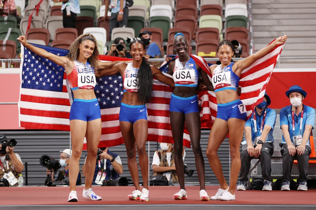 Sydney McLaughlin, Allyson Felix, Dalilah Muhammad and Athing Mu of Team USA celebrate winning the gold medal in the women' s 4 x 400m relay final on day fifteen of the Tokyo 2020 Olympic Games at Olympic Stadium on Aug. 7, 2021, in Tokyo, Japan.