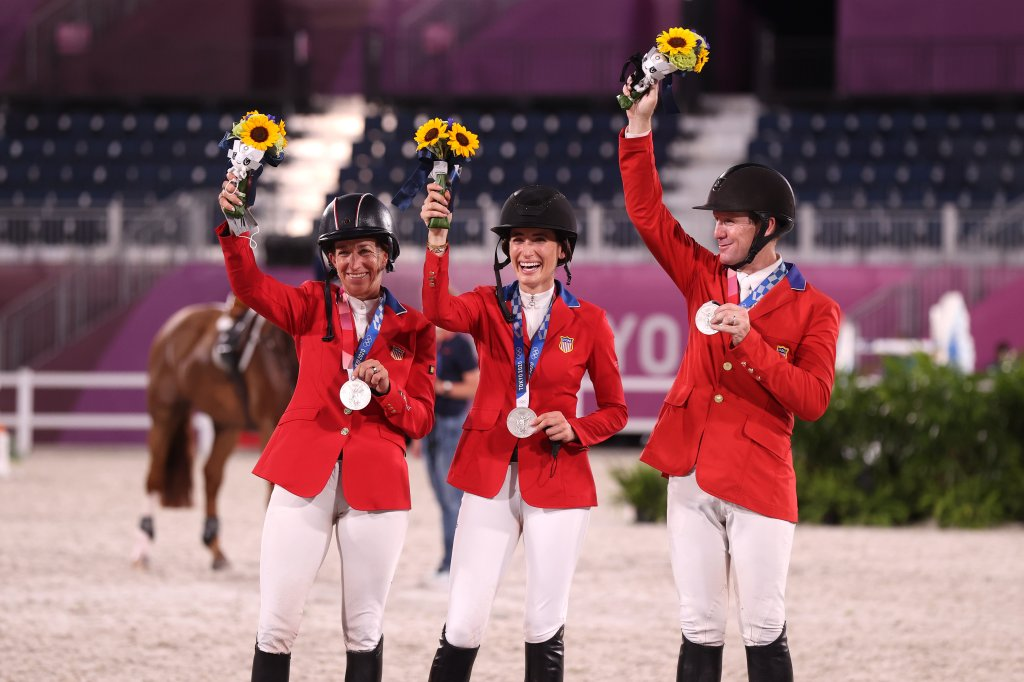 Laura Kraut, Jessica Springsteen and McLain Ward of Team United States pose with their silver medals on the podium during the jumping team final medal ceremony at Equestrian Park on Aug. 7, 2021 in Tokyo, Japan.