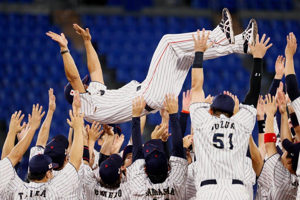 Team Japan celebrates during the gold medal game between Team USA and Team Japan on day fifteen of the Tokyo 2020 Olympic Games at Yokohama Baseball Stadium on Aug. 7, 2021 in Yokohama, Kanagawa, Japan.