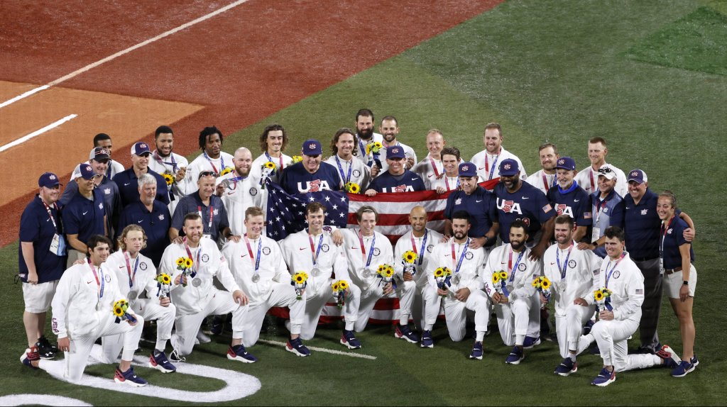 Silver medalists Team United States poses for photographs after the medal ceremony for baseball following the gold medal game between Team United States and Team Japan on day fifteen of the Tokyo 2020 Olympic Games at Yokohama Baseball Stadium on Aug. 7, 2021, in Yokohama, Kanagawa, Japan.