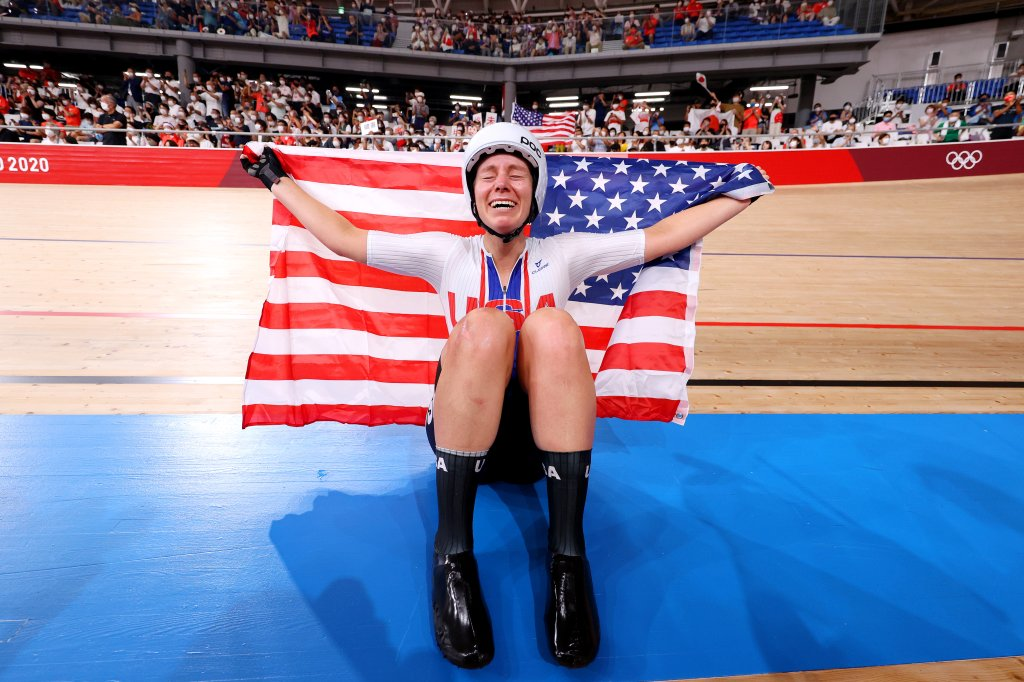 Jennifer Valente of Team United States celebrates winning the gold medal while holding the flag of her country during the Women's Omnium points race, 4 round of 4 of the track cycling on day sixteen of the Tokyo 2020 Olympic Games at Izu Velodrome on Aug. 8, 2021 in Izu, Shizuoka, Japan.