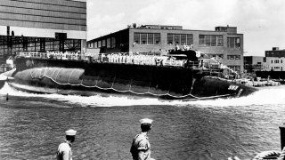 FILE - In this July 9, 1960 file photo, the 278-foot nuclear-powered attack submarine USS Thresher is launched at the Portsmouth Navy Yard in Kittery, Maine.