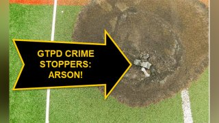 An overhead shot shows an arrow pointing to a charred baseball field devoted to disabled children.