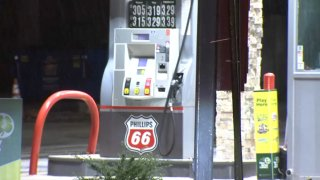 """A """"Route 66"""" logo can be seen at a gas station pump."""