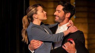 "Lauren German, left, and Tom Ellis in a scene from ""Lucifer"""