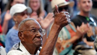 FILE - In this Sept. 12, 2019 file photo, World War II veteran Lawrence Brooks celebrates his 110th birthday at the National World War II Museum in New Orleans. Brooks celebrated his 112th birthday, Sunday, Sept. 12, 2021 with a drive-by party at his New Orleans home hosted by the National War War II Museum. Drafted in 1940, Brooks was a private in the Army's mostly Black 91st Engineer Battalion.