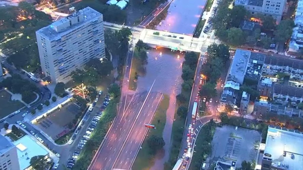 An aerial view shows the Schuylkill River overflowing onto lanes on Interstate 676 in Philadelphia on Thursday, Sept. 2, 2021.