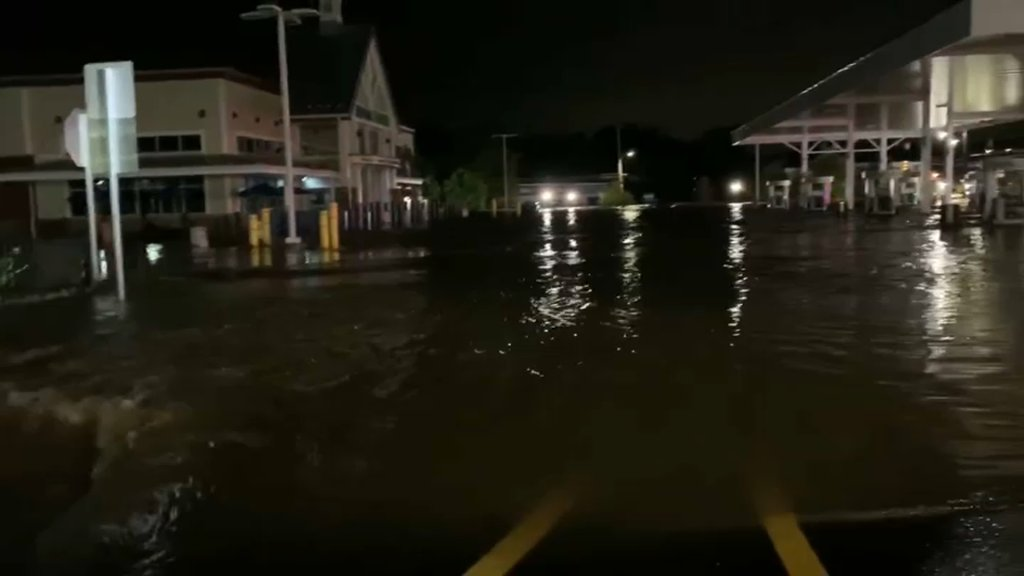 Floodwaters rise around a gas station store and the gas station pumps in Collegeville, Pennsylvania, on Wednesday, Sept. 1, 2021.