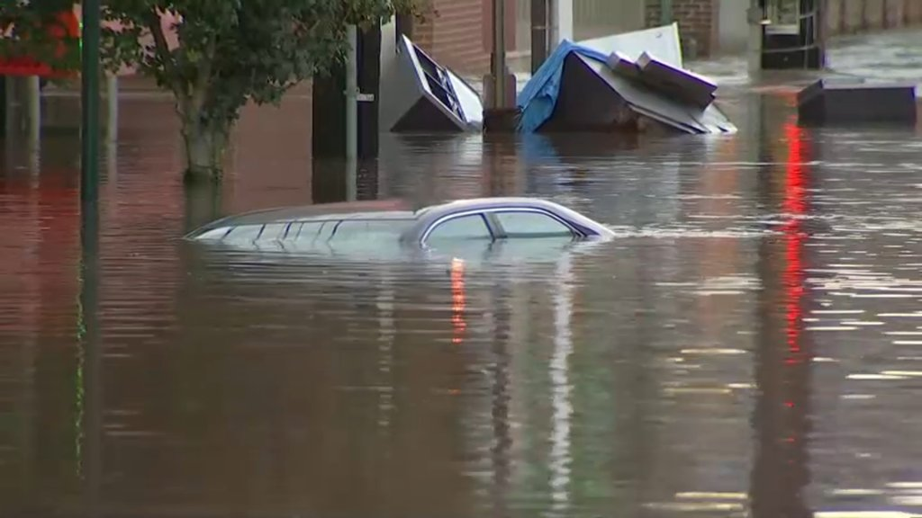 The roof of an almost fully submerged car can be seen after flooding in Philadelphia's Manayunk neighborhood on Thursday, Sept. 2, 2021. Debris can also be seen in the background.
