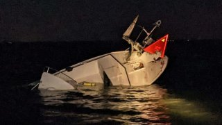 Part of a sunken boat sticks out of the water after a crash in New Jersey.