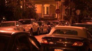 Cars line both sides of a West Philadelphia street