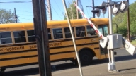 Crossing Gate Hits School Bus as Train Approaches