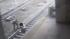 WATCH: Officer Pulls Man Off Tracks Before Train Arrives