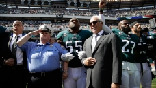 Eagles, Owner Lurie Link Arms During National Anthem