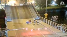 Shocking Video Shows Woman on Bike Fall Through Bridge Gap