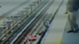 Caught on Cam: Baby Falls on Train Tracks
