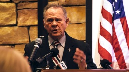 Fighting Scandal, Moore Stands With Homophobic Supporters