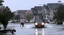 Man Surfs Down Flooded Street