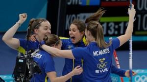 Feb. 25 Olympics Photos: 'Garlic Girls' Falls to Sweden