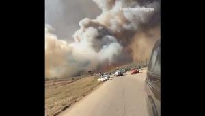 Wildfire Spreads Across Canada's Oil Sands Region