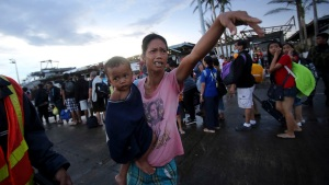 Thousands Look to Escape Misery in Typhoon-Hit City