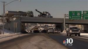 Tanker Truck Crashes. Hangs on Overpass