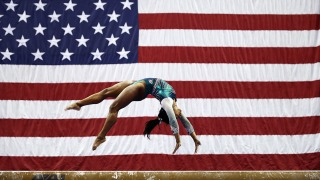 Top Sports Photos: Simone Biles Lands Historic Triple-Double, and More