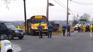 PHOTOS: School Bus Collides With Dump Truck