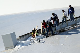 Fire Department Clears Ice from Stadium Roof Saturday