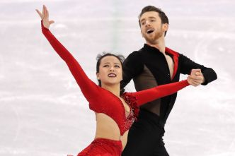 Olympic Ice Dancers Power Through Costume Malfunction