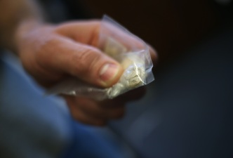 Suspect Tries to Dissolve Heroin With Pee