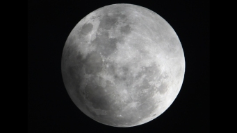 Partial Lunar Eclipse, Comet Starring in Night Sky Show