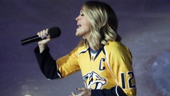 See Carrie Underwood Surprise Fans at Husband's Playoff Game