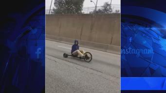 Watch: Man Pedals Big Wheel Down Roosevelt Boulevard