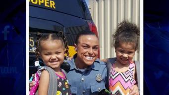 Delaware State Trooper Delivers Backpacks to Young Girls