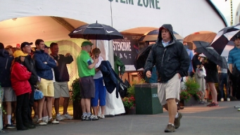 Fans Try to Escape the Rain at the U.S. Open